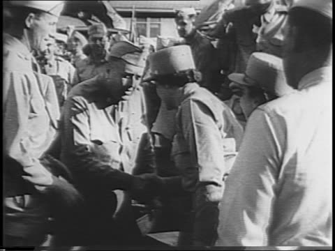 beach scene in hawaii / group of women's army corps descend gangplank in uniform / colonel lawton greets wacs / women board truck, eat in cafeteria... - military uniform stock videos & royalty-free footage