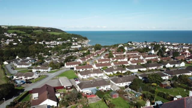 beach scenery of aberporth village / wales, uk - boulder rock stock videos & royalty-free footage
