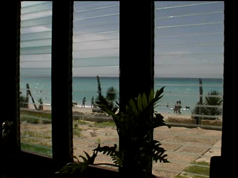 ms, beach seen through window, varadero, cuba  - jalousie stock-videos und b-roll-filmmaterial