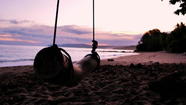 beach sunrise, montezuma, puntarenas province, costa rica: beach swing - puntarenas province stock videos & royalty-free footage