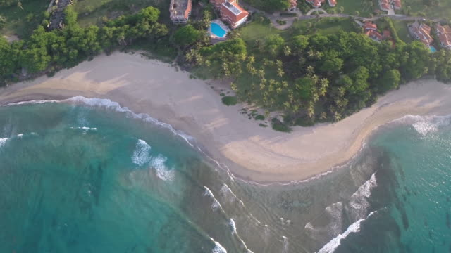 beach sunset low drone flyalong - dominican republic stock videos and b-roll footage