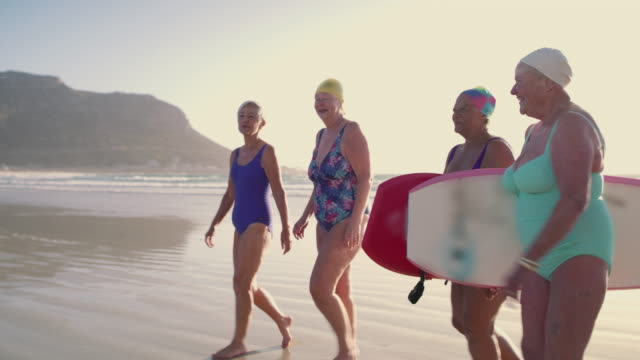 beach therapy is good for the old soul - senior adult stock videos & royalty-free footage