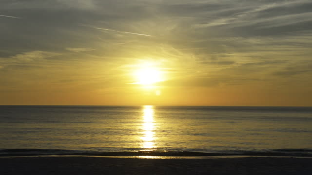 beach timelapse, sunset with people - anna maria island stock videos and b-roll footage