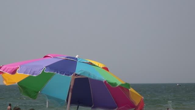 beach umbrella - hd 1080/60i - beach umbrella stock videos and b-roll footage