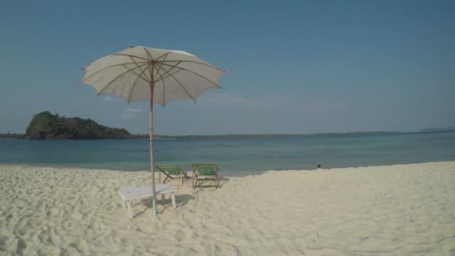beach umbrella on tropical islands - beach umbrella stock videos and b-roll footage