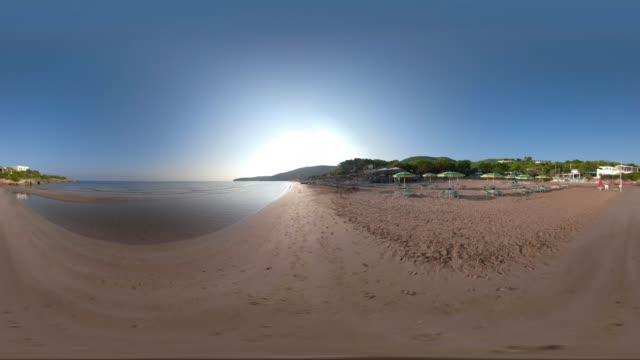 360 vr / beach umbrellas at baia san nicola beach at the adriatic sea - adriatic sea stock videos & royalty-free footage