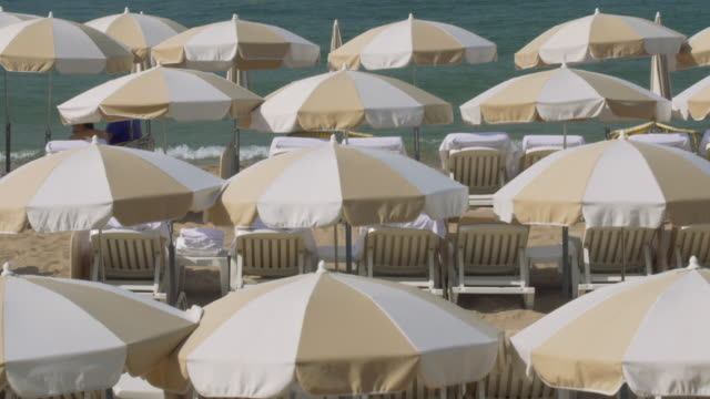 beach umbrellas at cannes. - cannes stock videos & royalty-free footage