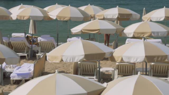 beach umbrellas at cannes. - parasol stock videos & royalty-free footage