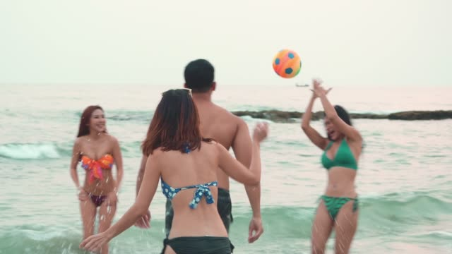 beach vacation playing hand ball - beach holiday stock videos & royalty-free footage
