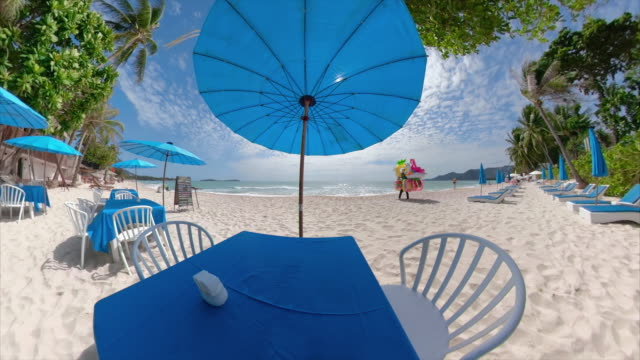 a beach vendor walks at the beach restaurant - life jacket stock videos & royalty-free footage