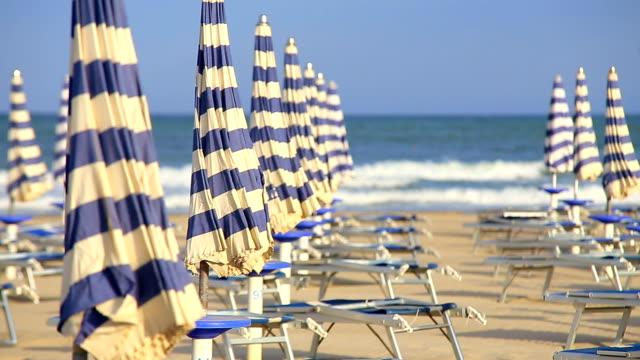 hd beach - beach umbrella stock videos and b-roll footage