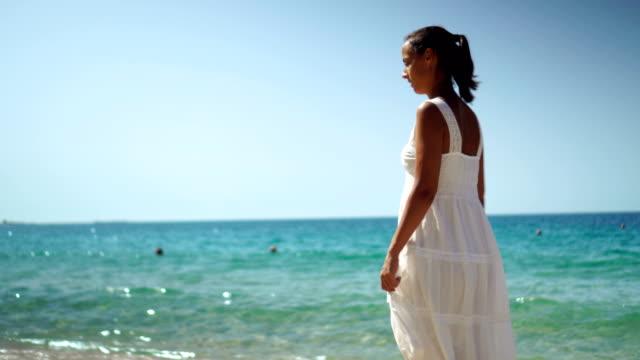 beach walk - dress stock videos and b-roll footage
