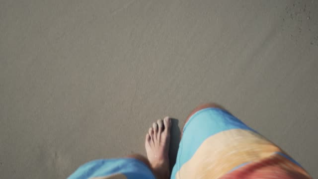 beach walk - swimming shorts stock videos & royalty-free footage