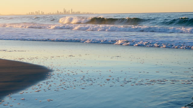 beach waves at sunset - non urban scene stock videos & royalty-free footage