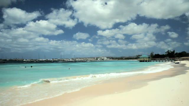 WS Beach with pier and boats in distance / Bridgetown, St Michael, Barbados
