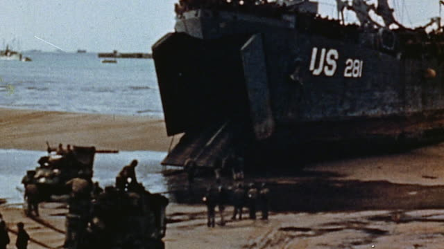 beached at low tide with soldiers unloading equipment / normandy, france - 1944 stock videos & royalty-free footage