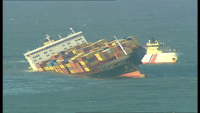 fears of oil and chemical spillage on devon coast general view of msc napoli tipping over in sea - itv weekend evening news stock-videos und b-roll-filmmaterial