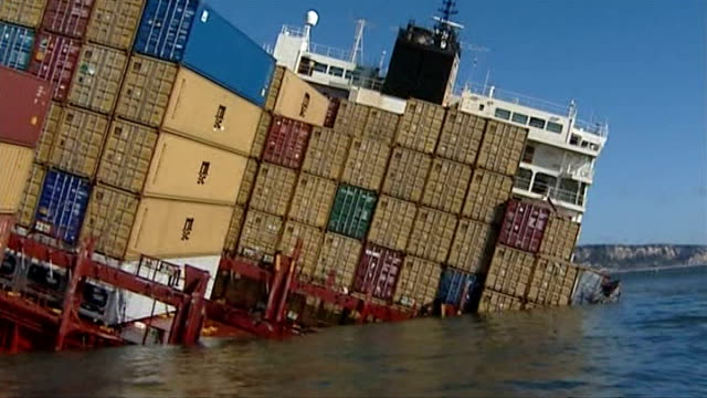 beached cargo ship/ scavengers criticised england off the coast of devon container ship 'napoli' listing in water track around oil damage to... - ship's bow stock videos & royalty-free footage