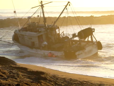 beached fishing boat - stranded stock videos and b-roll footage