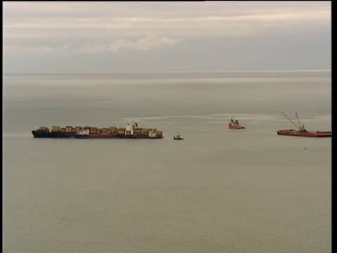 beached msc napoli cargo ship and floating crane; air view more of stranded container ship afloat in water off devon coat next crane vessel sent as... - vessel part stock videos & royalty-free footage