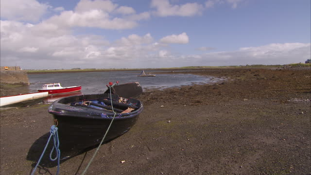 beached row boat with beautiful landscape - low tide stock videos & royalty-free footage