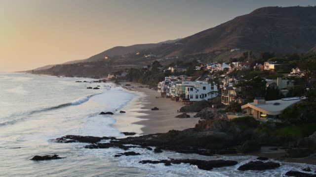 beachfront houses in malibu at sunset - aerial view - malibu stock videos & royalty-free footage