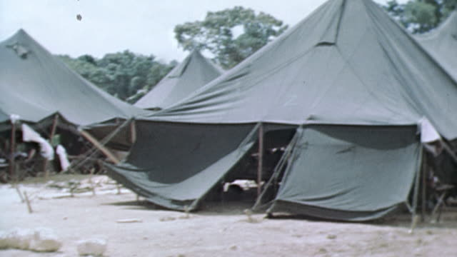 pan beachfront military camp tents cargo and vehicles / okinawa japan - military camp stock videos & royalty-free footage