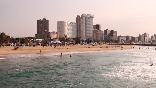beachfront with buildings, sand and ocean - durban stock videos and b-roll footage