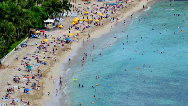 beachgoers at waikiki - honolulu stock videos and b-roll footage
