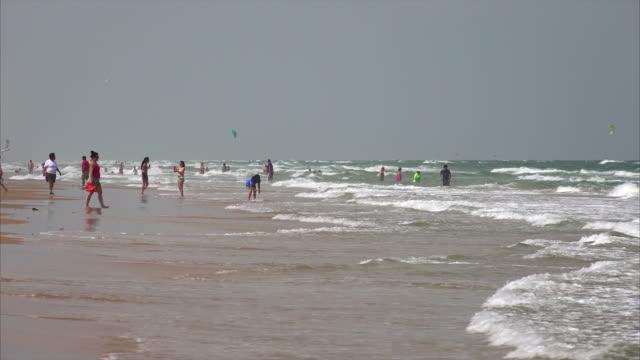 Beachgoers Enjoying the Beach on South Padre Island, Texas
