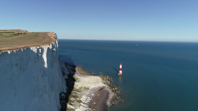 beachy head lighthouse aerial view on clear summer day - sunny stock videos & royalty-free footage