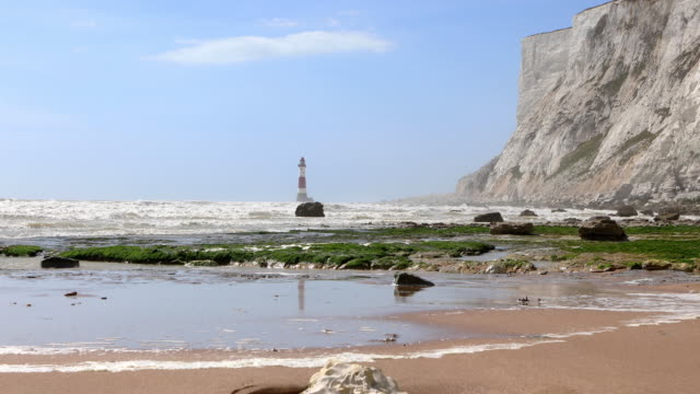 4k: beachy head lighthouse, eastbourne - eroded stock videos & royalty-free footage