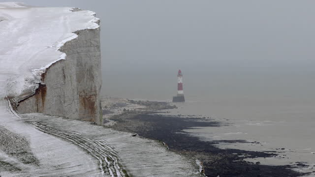 4k: beachy head lighthouse, winter scene, eastbourne - rock face stock videos & royalty-free footage