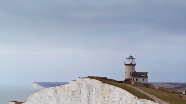 beachy head with seven sisters in distance - drone shot - coastal feature stock videos & royalty-free footage