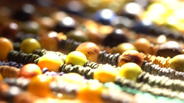 vídeos de stock, filmes e b-roll de bead - craft