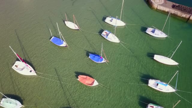 beadnell sailboats - northumberland coast stock videos & royalty-free footage
