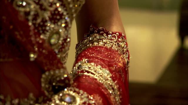 beads decorate a dress and sleeves. - gold dress stock videos & royalty-free footage
