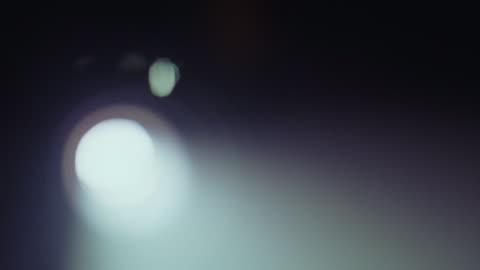 vídeos y material grabado en eventos de stock de a beam of light streaming from a film projector. - projection