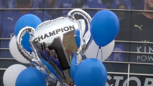 beaming fans wearing blue leicester city jerseys and twirling champions scarves mingled beneath bright sunshine outside the king power stadium on... - neckwear stock videos and b-roll footage