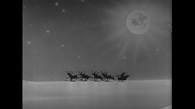 1946 A beaming moon highlights a small Santa and reindeer silhouette