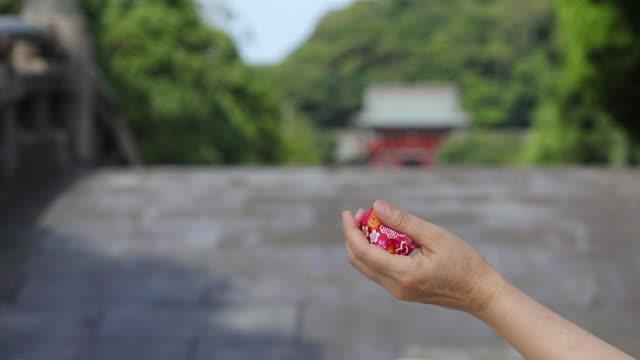 "beanbag, traditional japanese toy ""otedama"" in  ancient city kamakura, - shinto shrine stock videos & royalty-free footage"