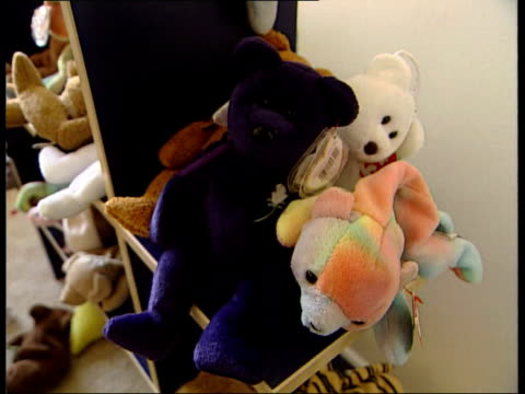beanie baby toy held by child vox pops cms beanie baby toys on shelf in child's room tgv children playing in bedroom with beanie babies - bedroom stock videos & royalty-free footage