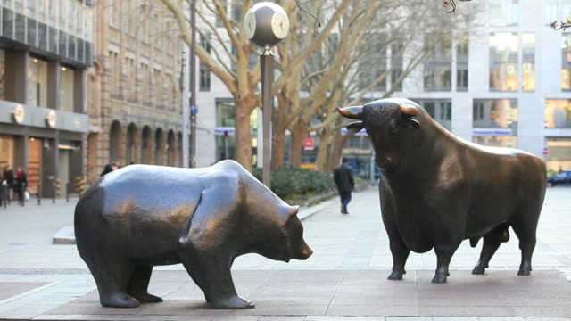 a bear and a bull statue stand as pedestrians pass outside the frankfurt stock exchange in frankfurt germany on monday march 24 close shot bronze... - frankfurt stock exchange stock videos and b-roll footage