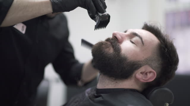 beard trimming - electric razor stock videos and b-roll footage