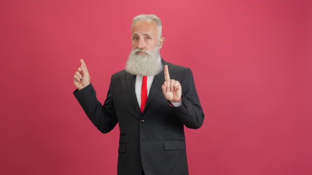 bearded adult businessman showing on copy space and showing a ban - big hair stock videos & royalty-free footage
