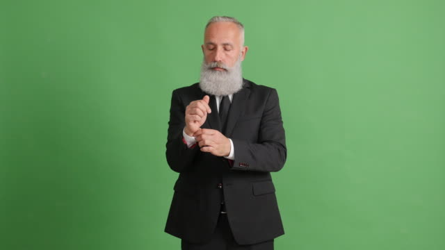 bearded adult businessman straightens clothes and smiles with his arms folded - beard stock videos & royalty-free footage