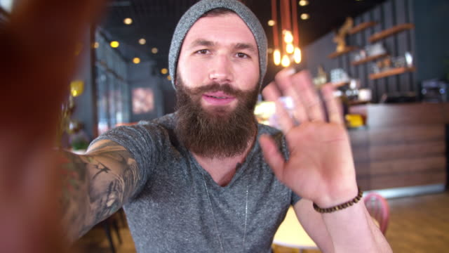 bearded and tattooed hipster video-calling - beard stock videos & royalty-free footage