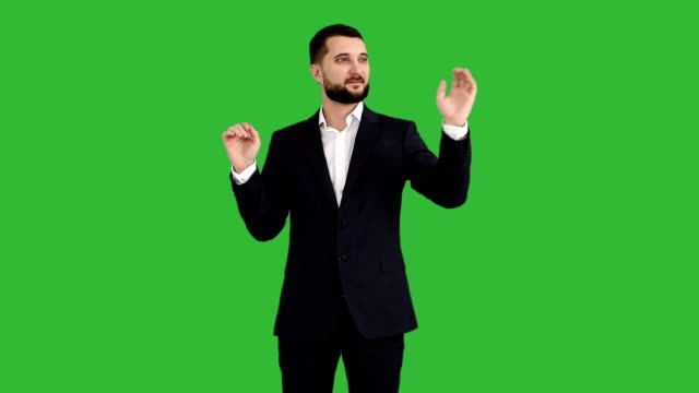 bearded businessman gesture controls on a green background