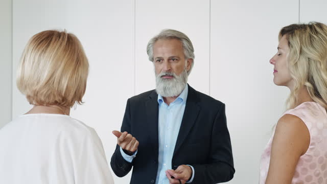 "bearded ceo talking with female executives in modern office - xavierarnau or ""xavier arnau serrat"" stock videos & royalty-free footage"