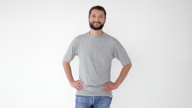 Bearded cheerful man giving thumb up gesture
